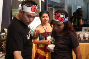 Zen Tea House staff assists attendees at their booth.