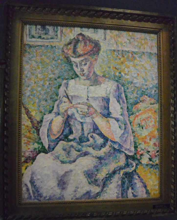 Women and art: A painting of a blonde woman crocheting done in an impressionist style.