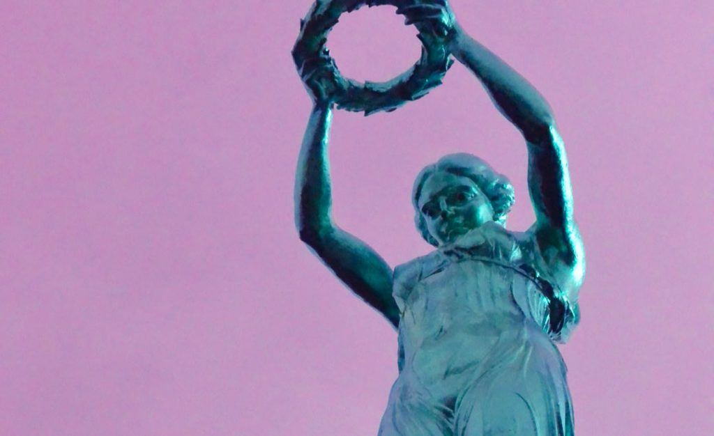 Women and art. Pop art peace statue of turquoise woman on pink background.