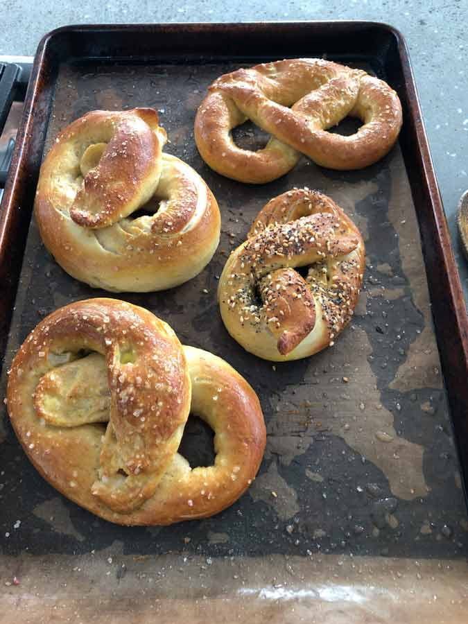 Co-workers baked. 4 big twisted pretzels on baking sheet. Yum!