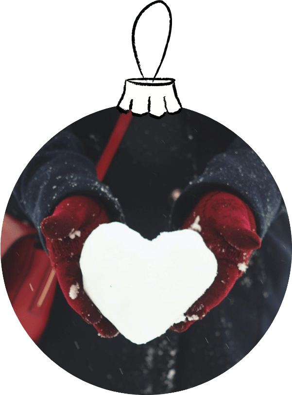 SnowChristmas ball depicting a snowball heart in gloved hands