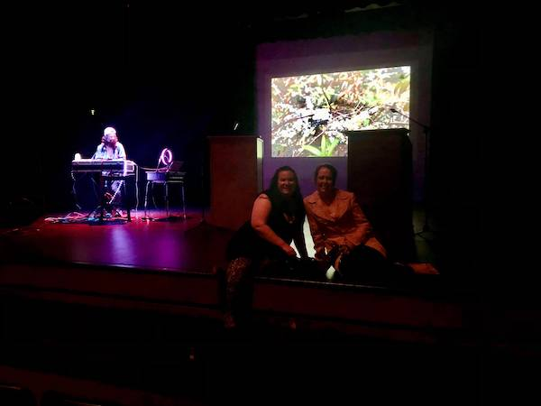 Myranda and Amber sitting on stage at the NorthWords Writers Festival