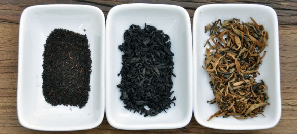A photo of the inside of a tea bag, loose leaf tea, and full leaf tea