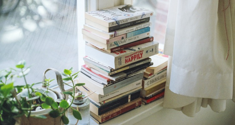 Stack of books on a pretty windowsill