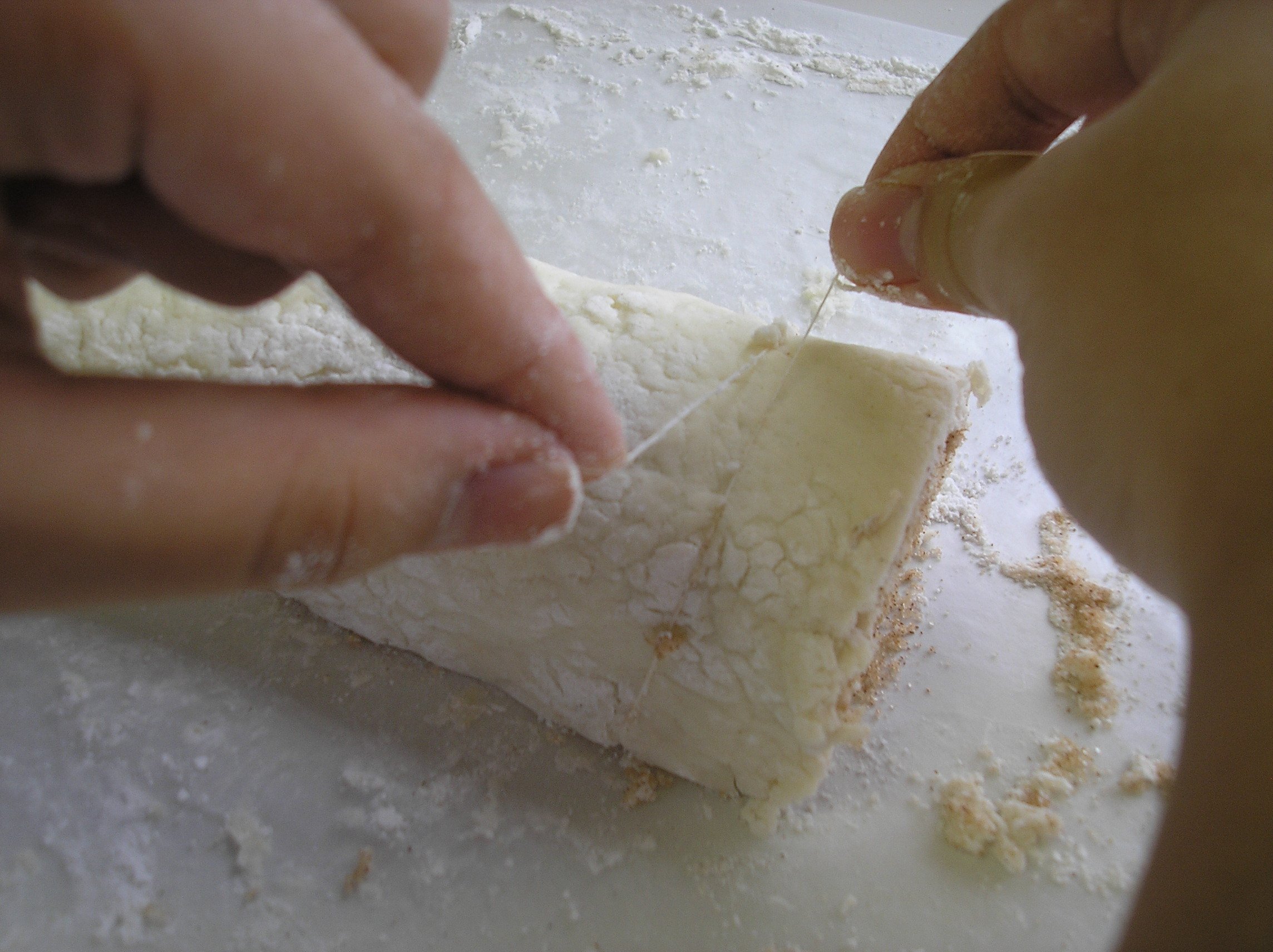 Place floss under the dough and pull to middle