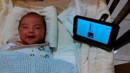Hunter in Taiwan listening with 14 day old son
