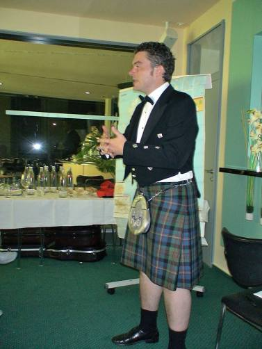 Carrick, doing his presentation about single malt whiskies
