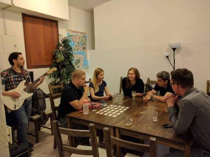 Moscow LEPsters playing a game, with electric guitar