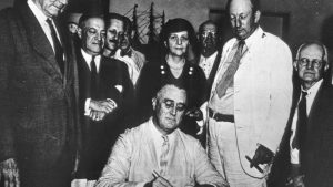 President Roosevelt signing the New Deal.