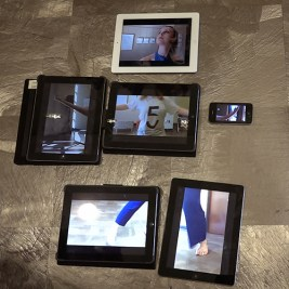 iPads arranged on the floor to show different images of a dancer