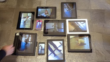 iPads arranged on the floor to show images of a dancer at different angles