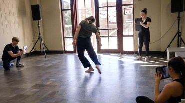 3 students filming a dancer with iPads