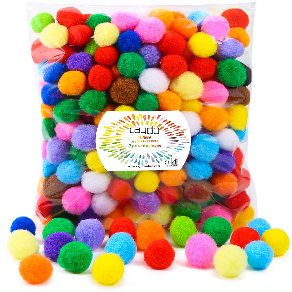 This pompom whisk toddler activity works on skills including fine motor, learning, and sensory. Using multicolored poms help to learn colors and count.