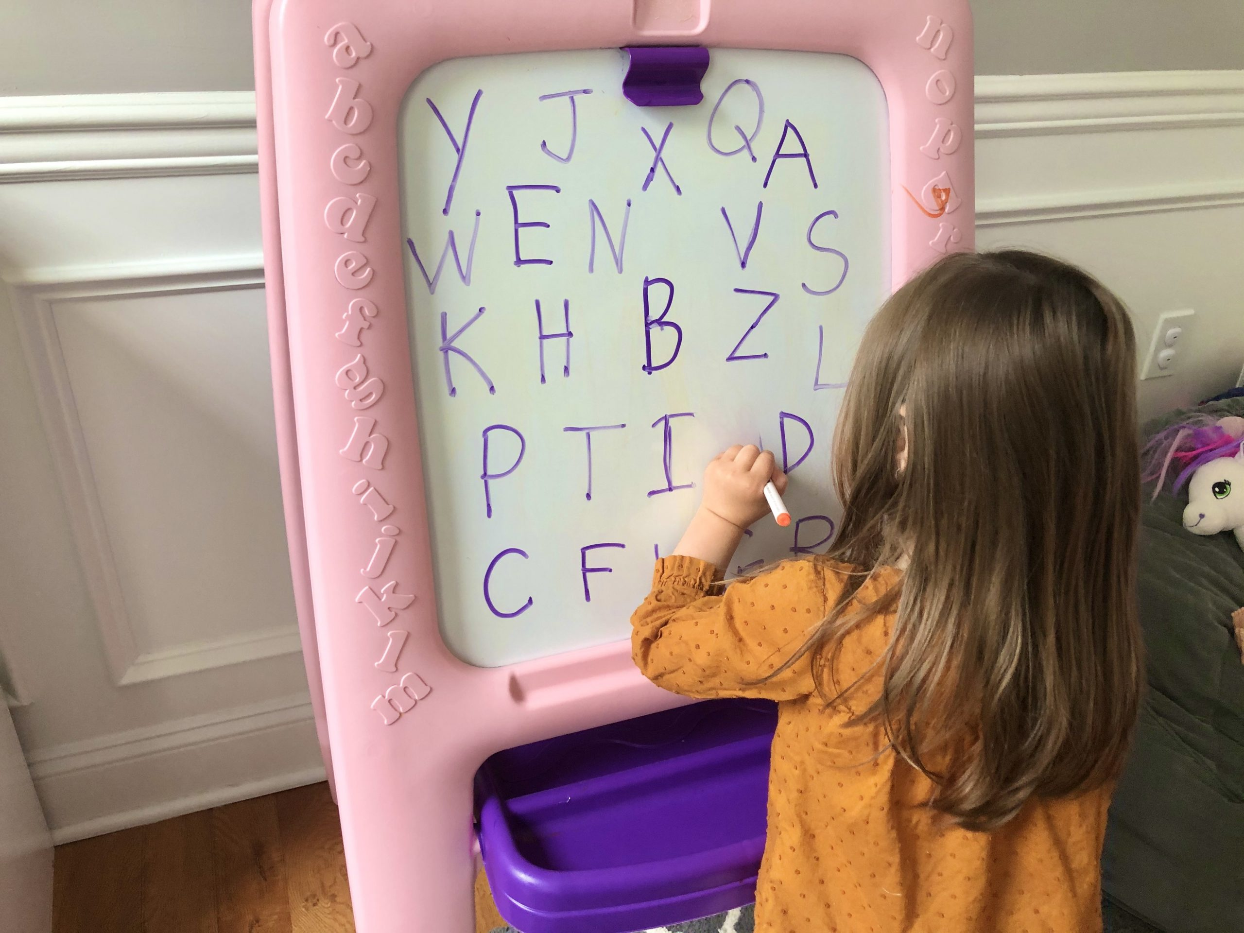 Teach your toddlers letters with this multisensory activity using a dry erase board and eraser. They will learn letter recognition quickly.