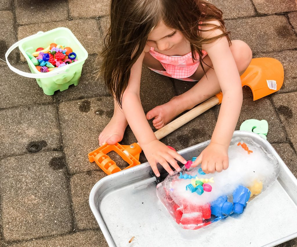 Try this ice block toy dig activity with your toddler for a great sensory experience and to beat the heat and keep cool while outside in the hot, summer sun.