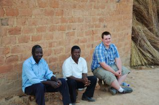 John with the male cultural interpreter and Mr. Sakala