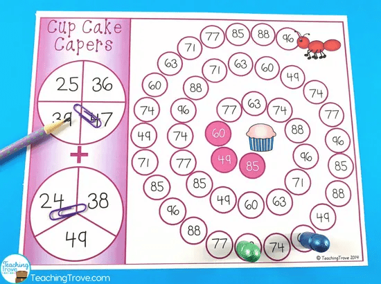 Use games to make double digit addition with regrouping fun.
