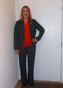 interview attire, grey Calvin Klein suit, grey pants, grey blazer, red sleeveless top, black and grey shoes, cat pin