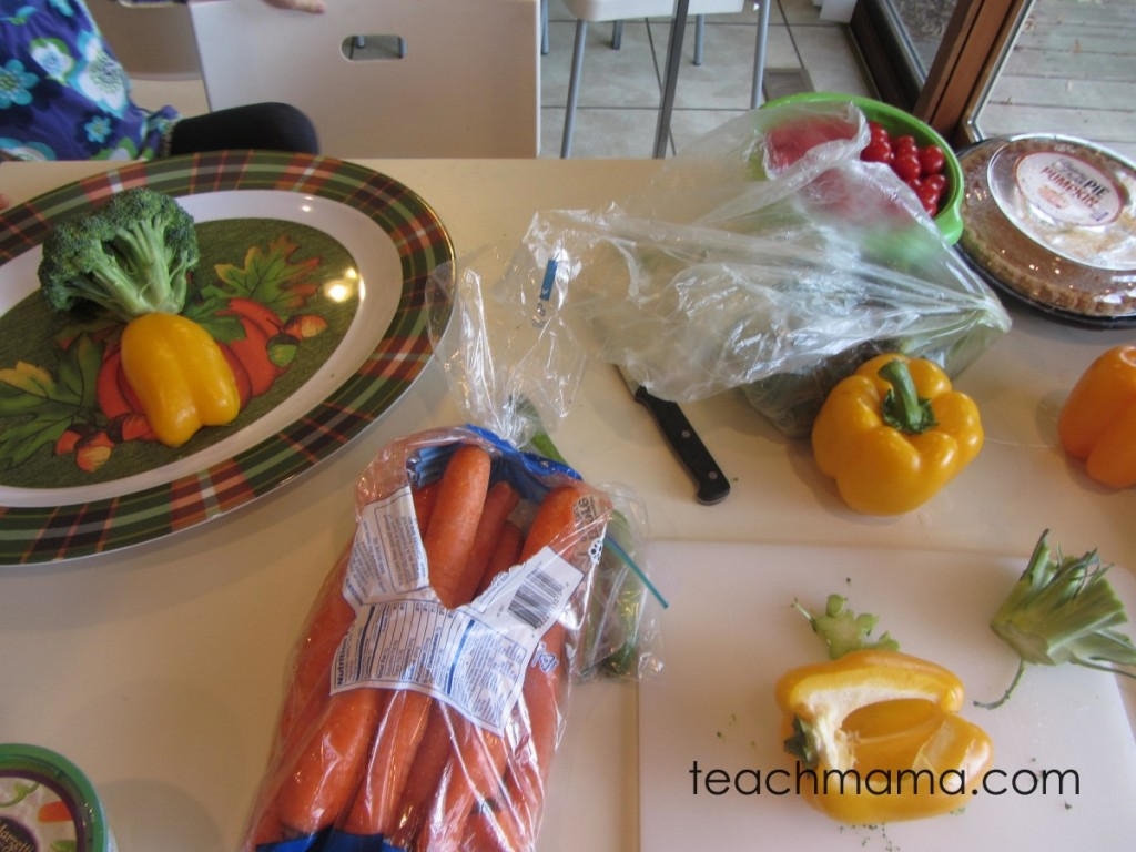 carrots, peppers, and tomatoes on counter