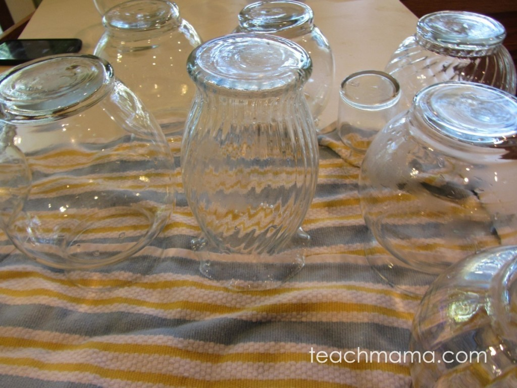 10 glass vases drying after being washed