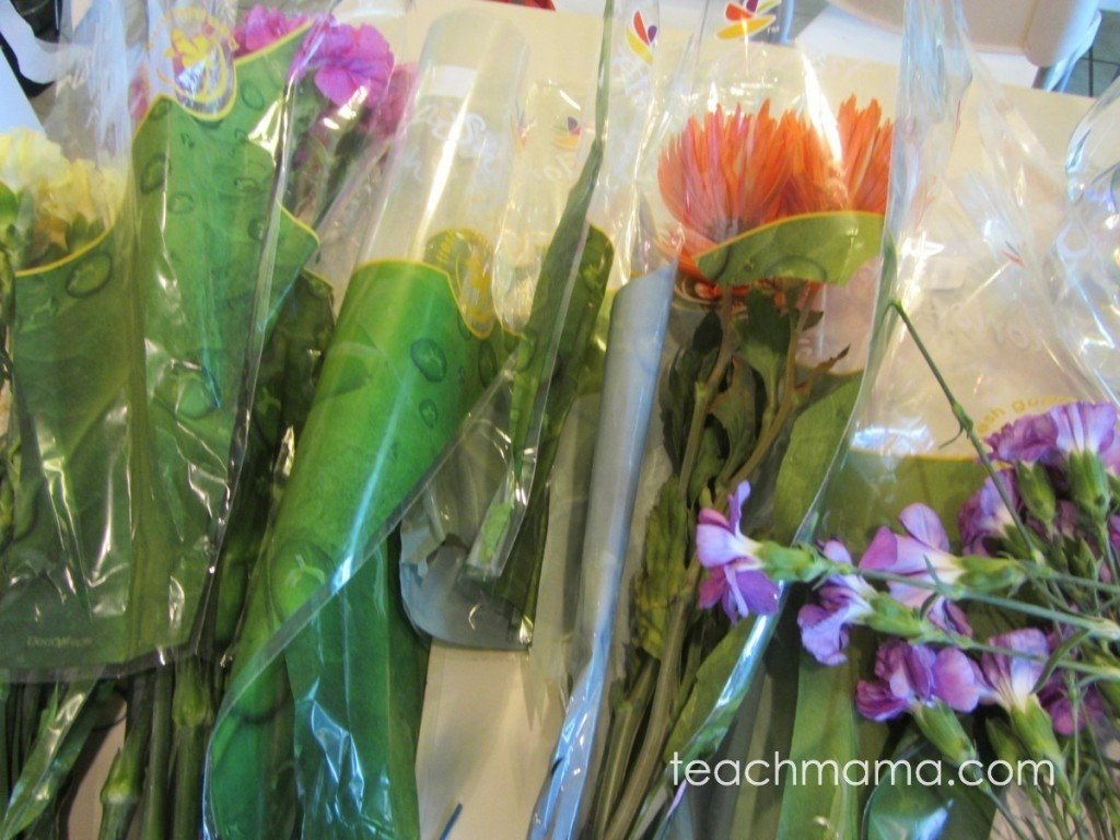many bouquets of flowers on counter