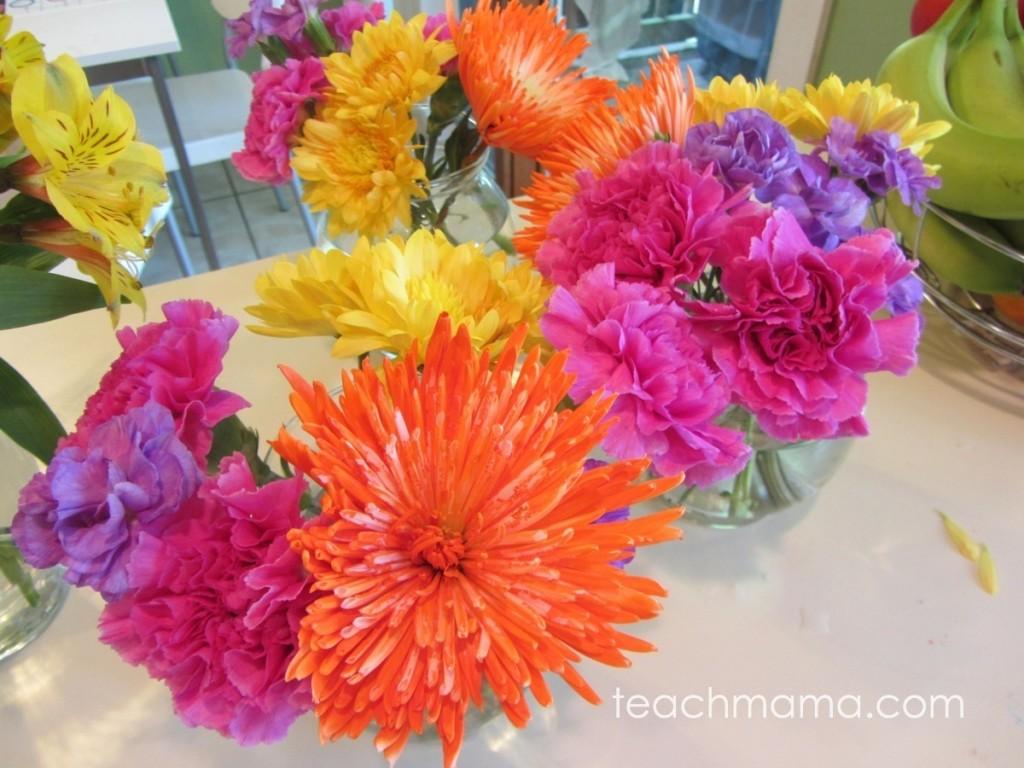 bright orange, pink, purple flowers in vases