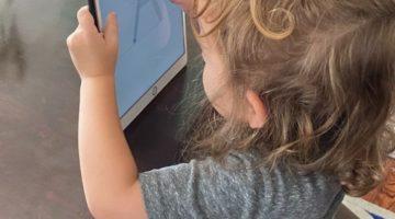 girl playing with duolingo abc