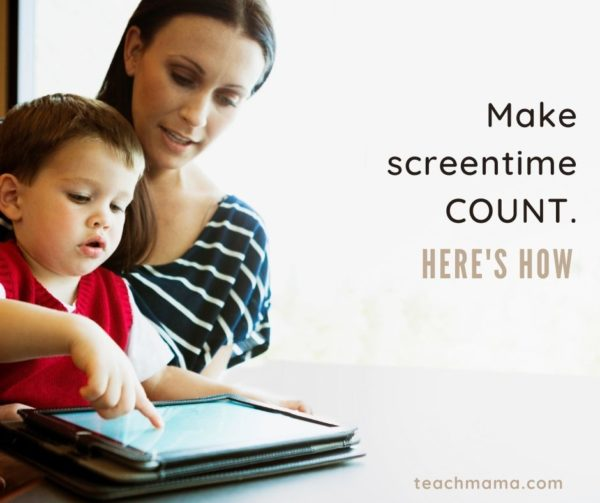 child playing on ipad with parent