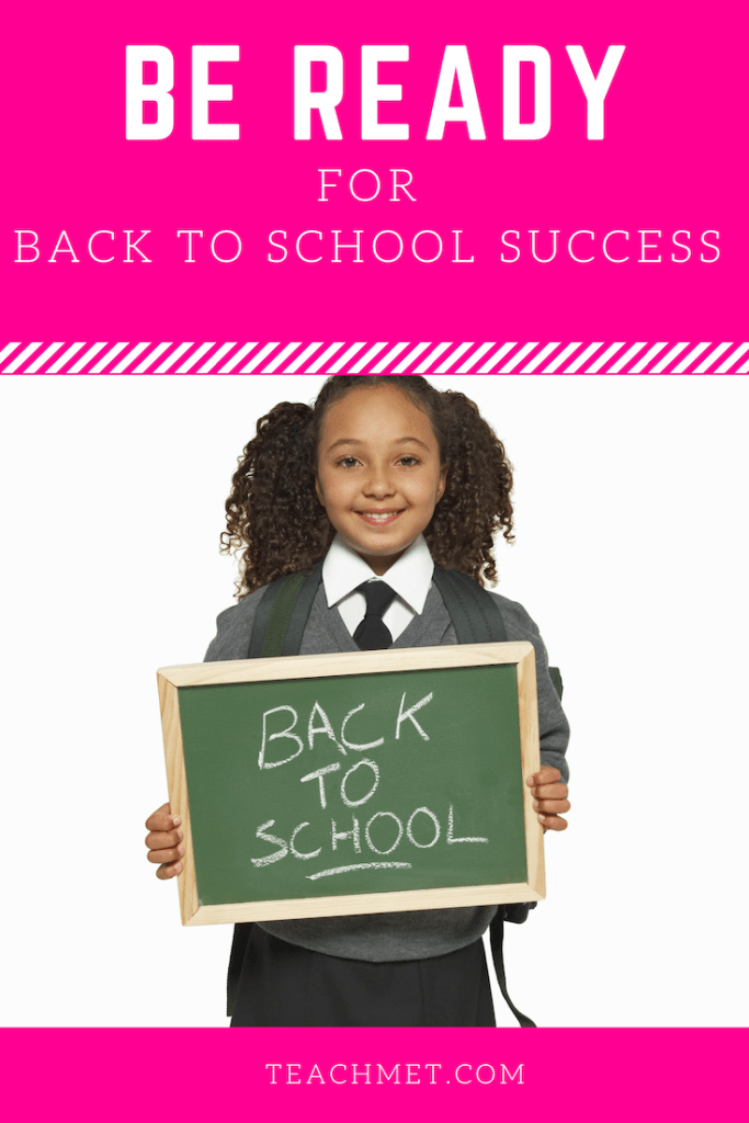 "A Pinterest pin for the blog post ""Be Ready For Back to School Success"".  Pictured is a young, smiling girl with her hair in two ponytails.  She has dark brown/black curly hair.  She is dressed in a grey, white, and black school uniform and is holding a sign that reads ""Back to School""."