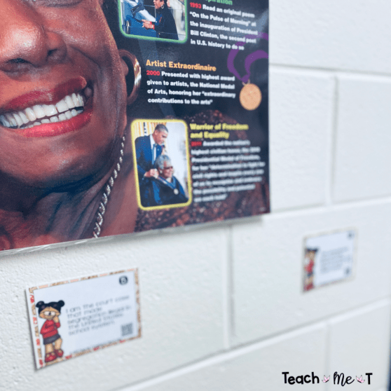 2 Famous People in Black History task cards displayed on a white concrete wall.  Both cards show a clipart image of an African American girl wearing glasses and a red sweater.  There are clues for students to figure out on each card.  Showing teachers how they can limit students' touching of task cards while using them for instruction.