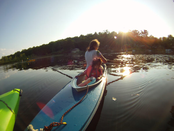 Dawn Smith-Pliner and Isabella on a kayak in a lake in Vermont.
