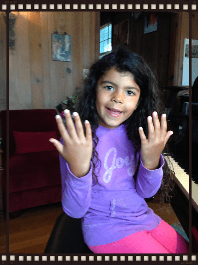Ella discussing her fingernail choices.