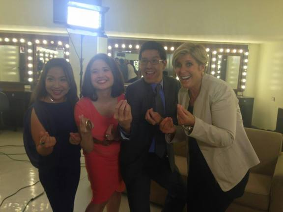 Edric and his co-hosts with Suze Orman