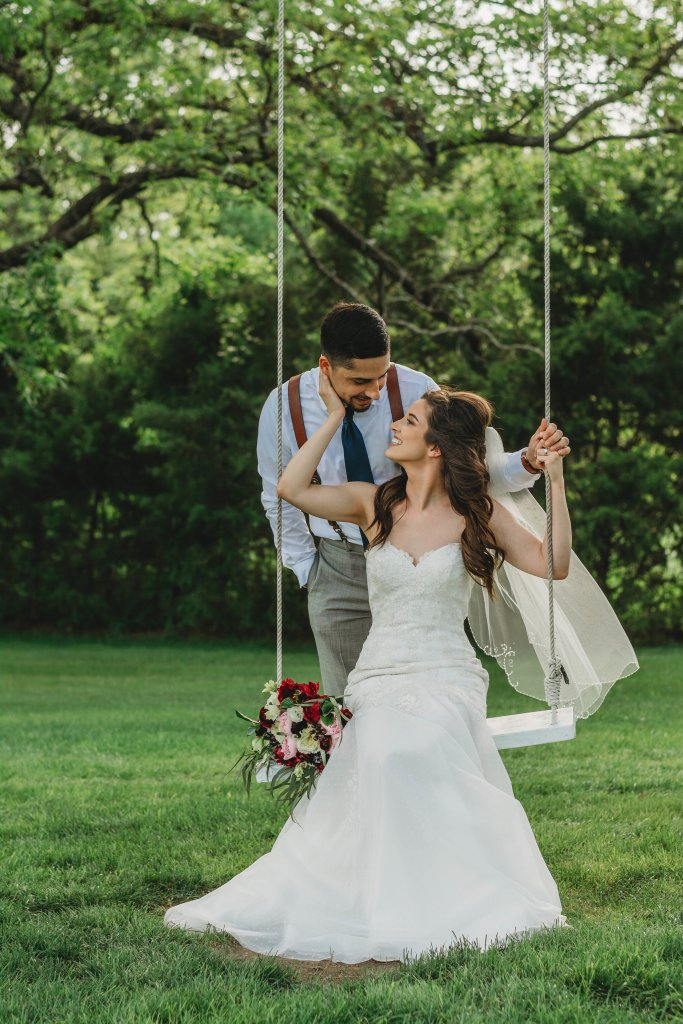 Bride and groom in garden swing photo ideas