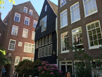 The darkest building (center) is believed to be among the oldest sanding building in Amsterdam.