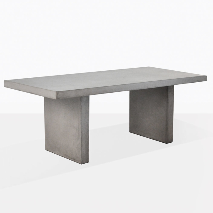 raw concrete rectangle dining table