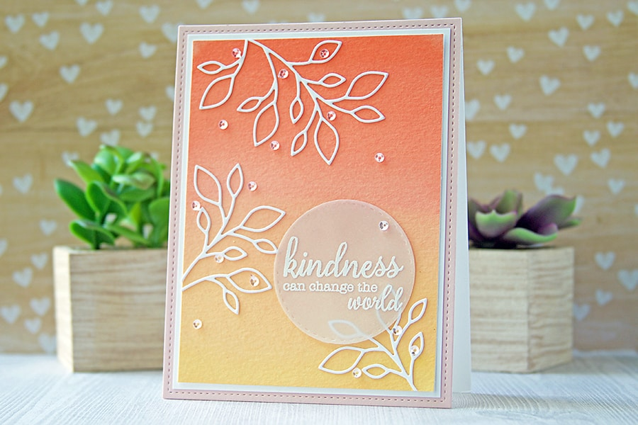 White die cuts on a watercolor painted background. Beautiful ombré effect!