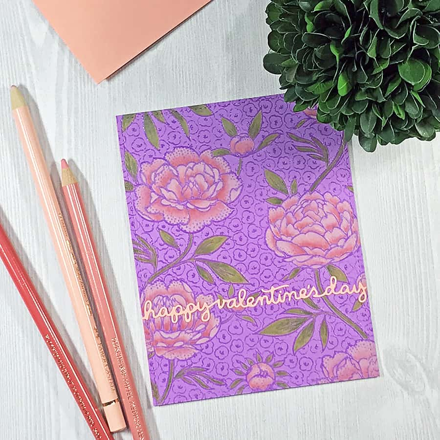 A Hand-Colored Floral Valentine, completed card. Rosy pink flowers colored with opaque pencils over a bright purple background.
