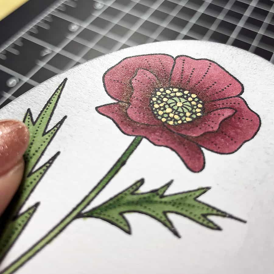 Coloring a Poppy With Copic Markers. Adding illumination to the center of the poppy with a gold permanent marker