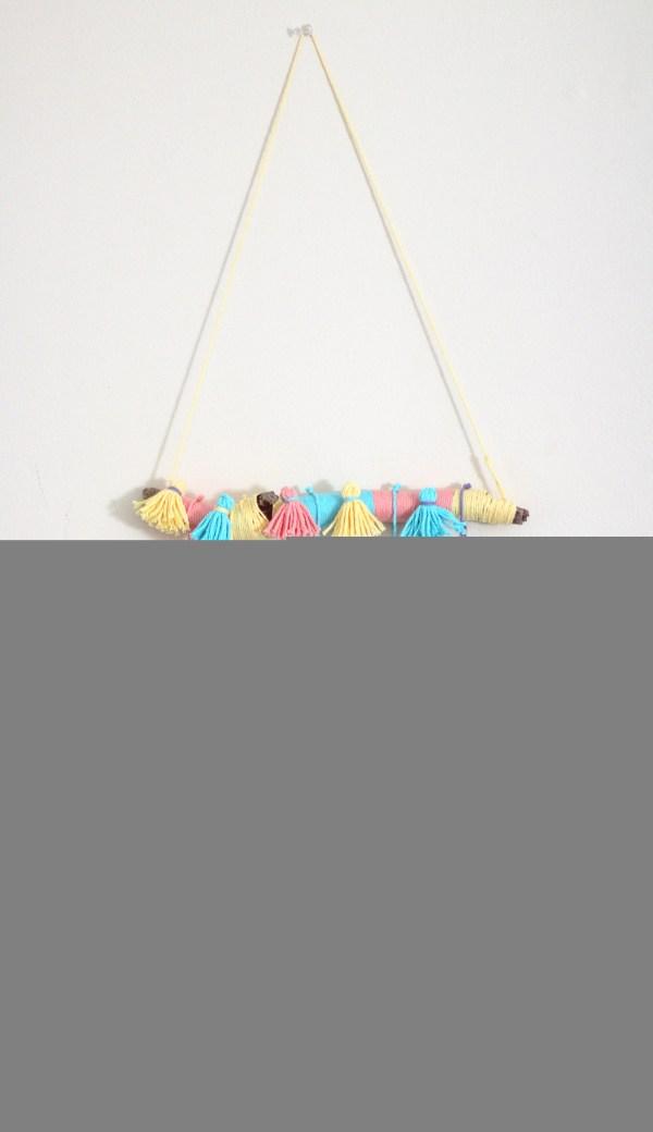 yarn tassel wall hanging diy   how to decorate boring walls