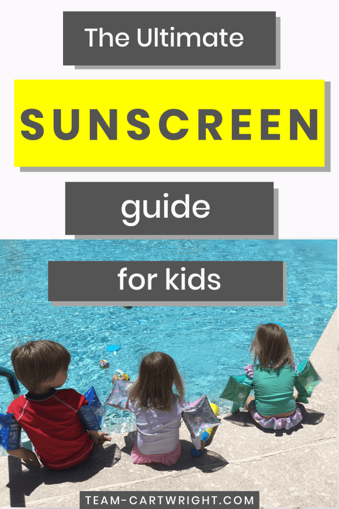 The Ultimate Sunscreen Guide for Kids with picture of 3 young children sitting facing a swimming pool