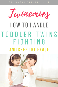 Picture of twins pestering each other with text overlay: Twinemies: How to handle toddler twins fighting and keep the peace