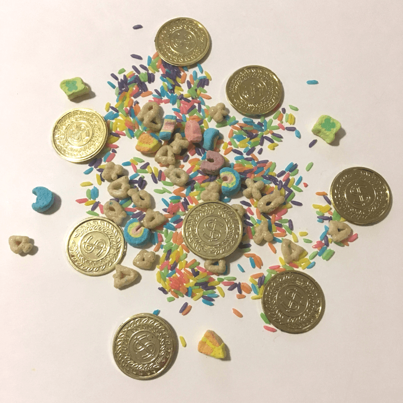 St. Patrick's Day STEM for toddlers and preschoolers. Leprechaun traps, leprechaun snow, rainbow rice, engineering challenges, penny boats and more! #StPatricksDaySTEM #StPatricksDayScience #LeprechaunSnow #SensoryBins #ScienceActivity Team-Cartwright.com
