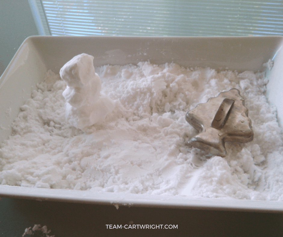 Make fake snow that is actually cold with just 2 ingredients! Easy and fun Christmas science experiments for kids. #christmasscience #christmasSTEM #christmas #STEM #science #learningactivity #kids #toddlers #preschool Team-Cartwright.com