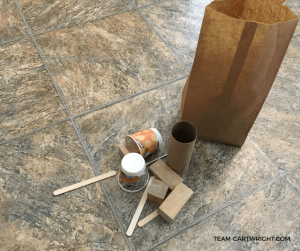 Mystery Tinker Tower Bag with blocks, cups, and craft sticks. How to Make Mystery Tinker Bags for Creative STEM Fun. #Stem #toddler #preschool #homeschool #craft #art #activity Team-Cartwright.com