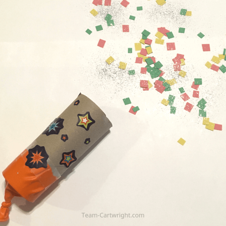 Homemade Confetti Poppers! Learn how to make this simple and fun craft for a fun celebration! It is a great creative project and a wonderful learning activity. Plus you can learn some science! #NewYearsEveCraft #DIYConfettiPopper #HomemadeConfettiPopper #GenderRevealConfettiPopper #LearningActivity #ToddlerLearning #PreschoolLearning #BirthdayParty Team-Cartwright.com