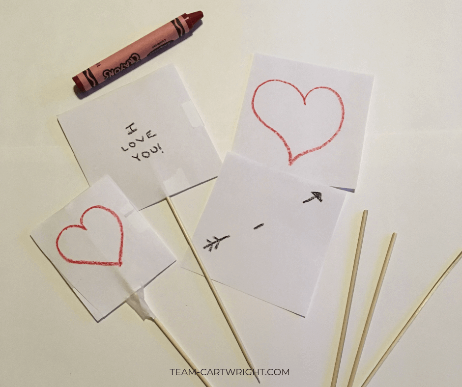 Learn how to make Thaumatropes for kids! These simple Valentine's Day cards create a classic optical illusion that will wow their friends. #STEAM #ValentinesDayCard #Thaumatrope #STEMActivity #ValentineSTEM #ValentineCraft #HomemadeValentine Team-Cartwright.com