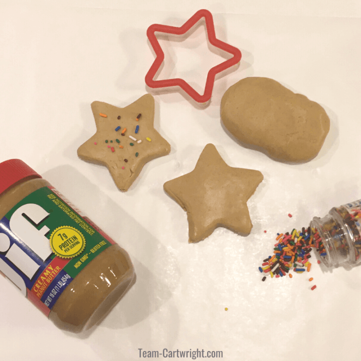 picture of peanut butter playdough, star cookie cutter, sprinkles, and jar of peanut butter
