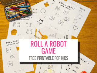 Text: Roll A Robot Game Free Printable for Kids Picture: Roll a Robot printables on a table with crayons, red dice, scissors, glue, and robot put together through playing game