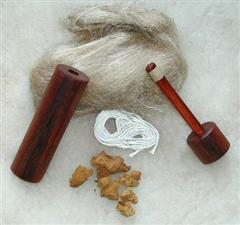 Fire piston, photo from http://www.survivalschool.com/products/fire_starting/Fire_Pistons.htm